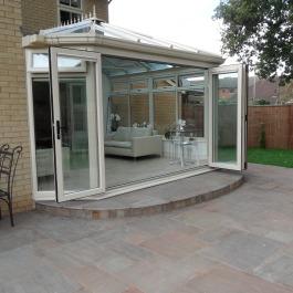 white bi-folding upvc doors on Crean conservatory
