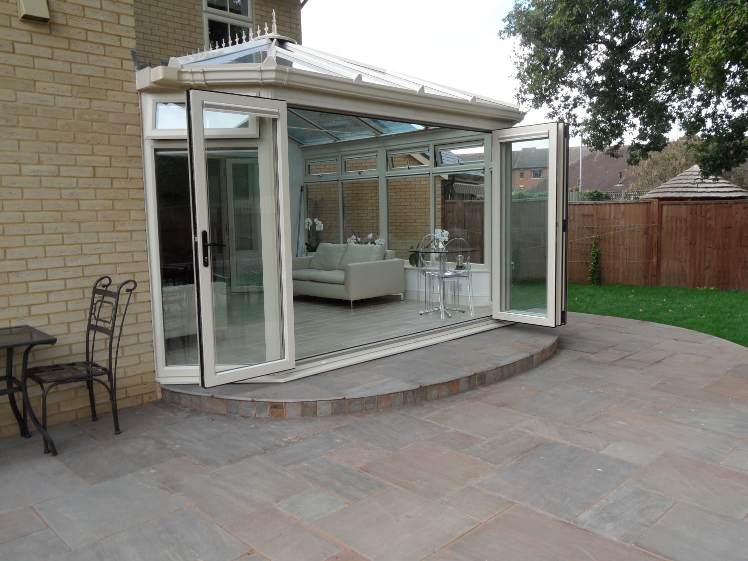 white bi-folding upvc doors on Crean conservatory