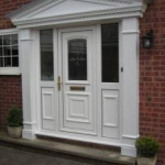 White panelled door with surround