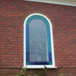 Arch Window with coloured leaded lights