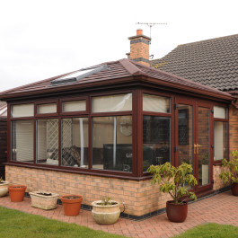 Red tiled equinox conservatory roof