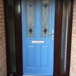 blue door with a black frame