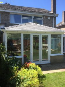 Equinox Conservatory with white framed glazing and French Doors